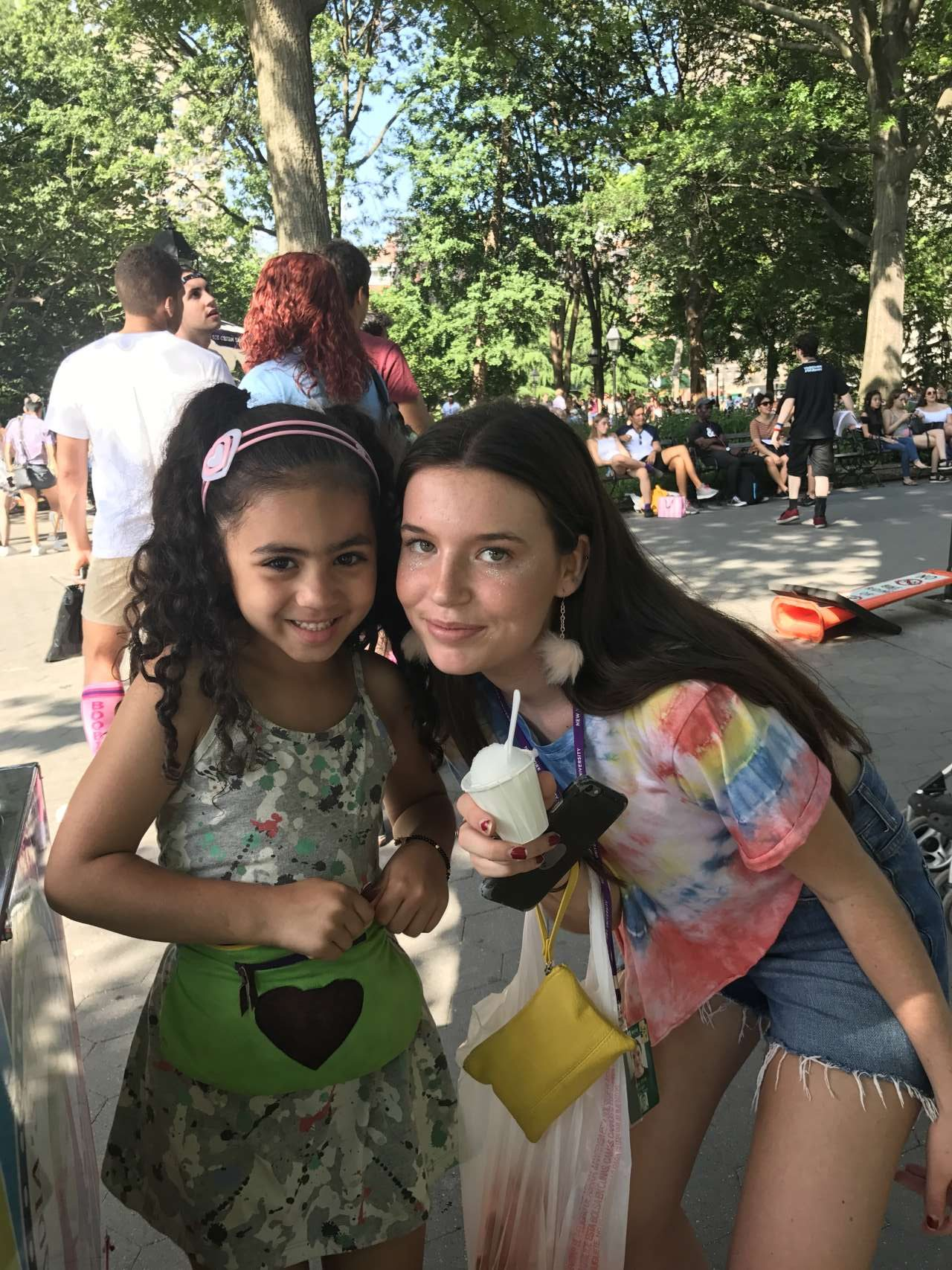 2 girls posing for a photo with lemon italian ice and India Jolie in park